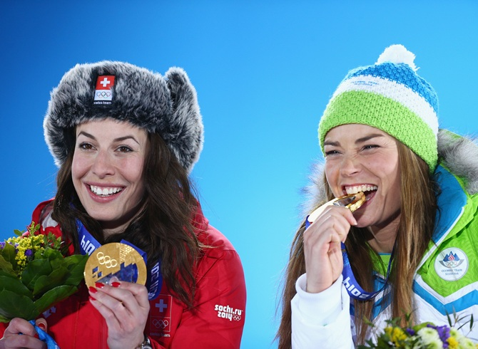 Joint gold medalists Dominique Gisin of Switzerland and Tina Maze of Slovenia celebrate.