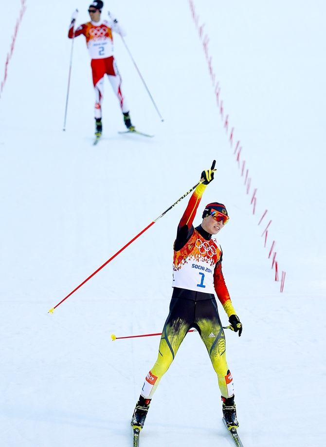 Eric Frenzel of Germany celebrates as he wins the gold   medal ahead of Akito Watabe of Japan during the Nordic Combined Individual Gundersen Normal Hill.