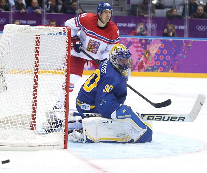 Henrik Lundqvist of Sweden tends goal against Czech Republic during the Men's Ice Hockey Preliminary Round