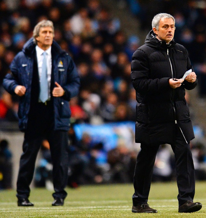 Manuel Pellegrini manager of Manchester City and Jose Mourinho manager of Chelsea give instructions.