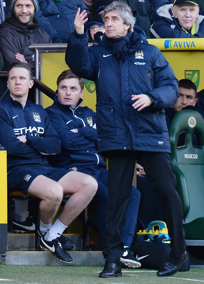 Manuel Pellegrini, manager of Manchester City shouts his instructions fron the bench.