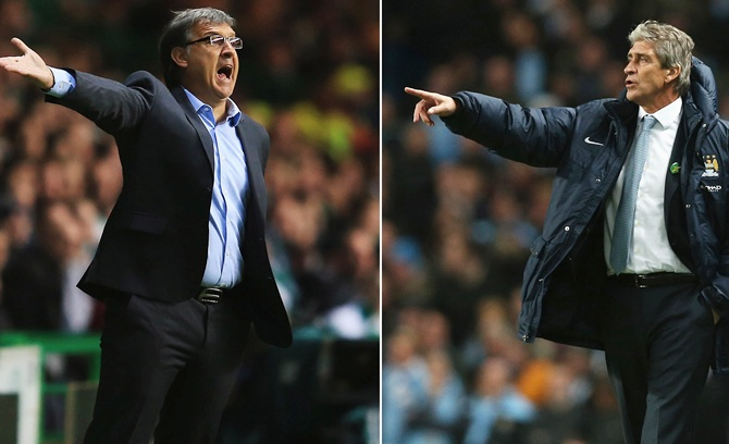 Gerardo Martino of FC Barcelona, left, and  Manchester City manager Manuel Pellegrini