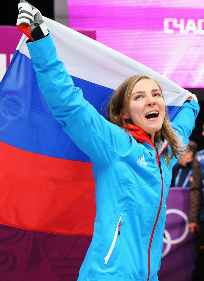 Bronze medalist Elena Nikitina of Russia celebrates during the flower ceremony for the Women's Skelton.