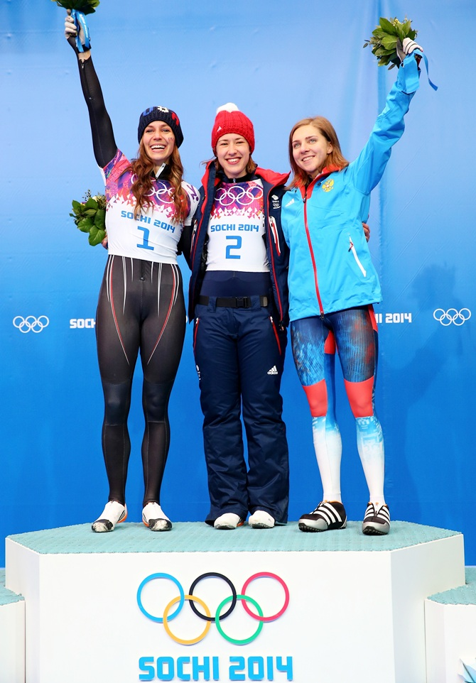 From left, Silver medalist Noelle Pikus-Pace of the United States, gold medalist Lizzy Yarnold of Great Britain and bronze medalist Elena Nikitina of Russia celebrate on the podium