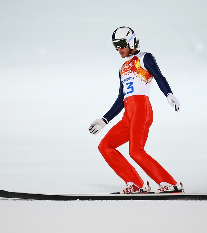 Anders Johnson of the United States lands after a jump during the Men's Normal Hill Individual Qualification.