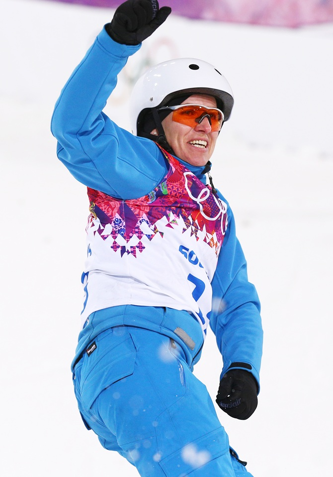 Alla Tsuper of Belarus celebrates after her run in the Freestyle Skiing Ladies' Aerials Finals.
