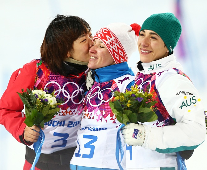 From left, Silver medalist Xu Mengtao of China, gold medalist Alla Tsuper of Belarus and bronze medalist Lydia Lassila of Australia celebrate on the podium.