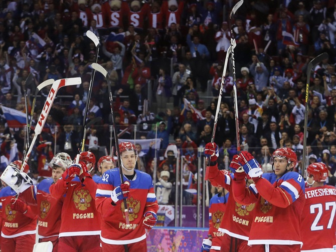 Russian men's ice hockey team celebrate winning against Slovenia.