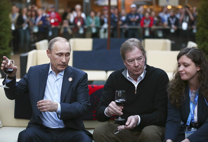 Russian President Vladimir Putin,left, and US Olympic Committee chairman Larry Probst.