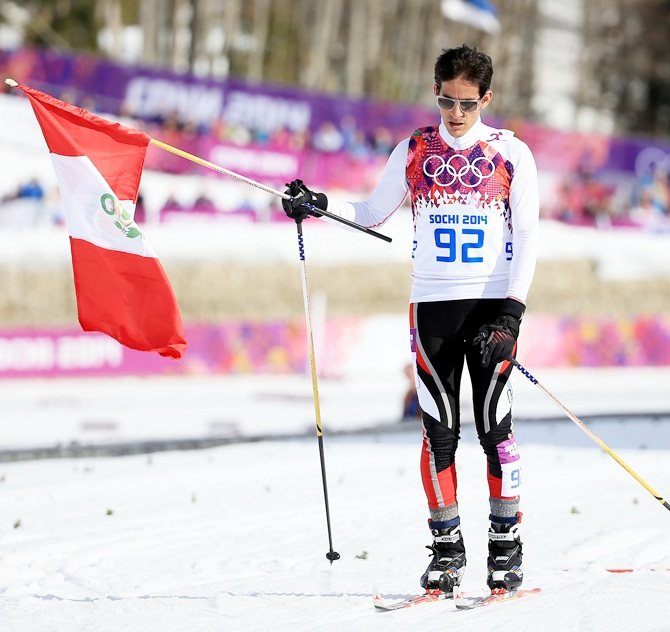 Roberto Carcelen of Peru crosses the finishing line in the Men's 15 km Classic.