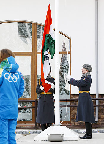 Russian soldiers raise India's national flag during the welcoming ceremony for the team in the Olympic athlete's village, which stands on a mountain plateau in Rosa Khutor, during the 2014 Winter Olympic Games on Sunday