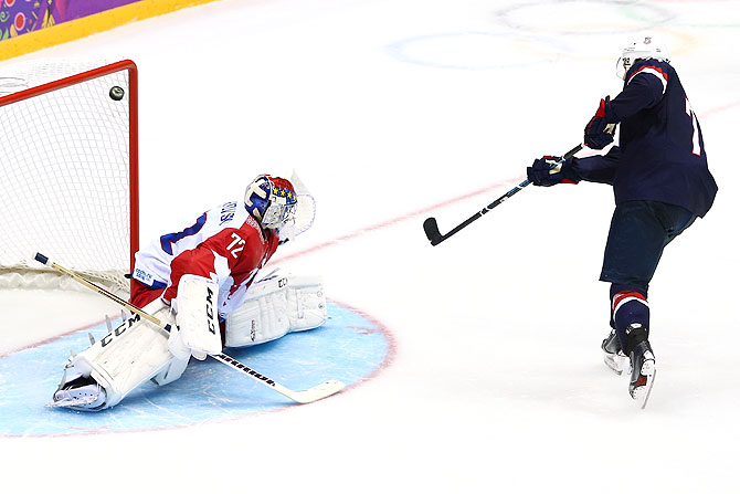 T.J. Oshie #74 of the United States scores on a shootout against Sergei Bobrovski #72 of Russia during the Men's Ice Hockey Preliminary Round Group A game at Bolshoy Ice Dome on Saturday