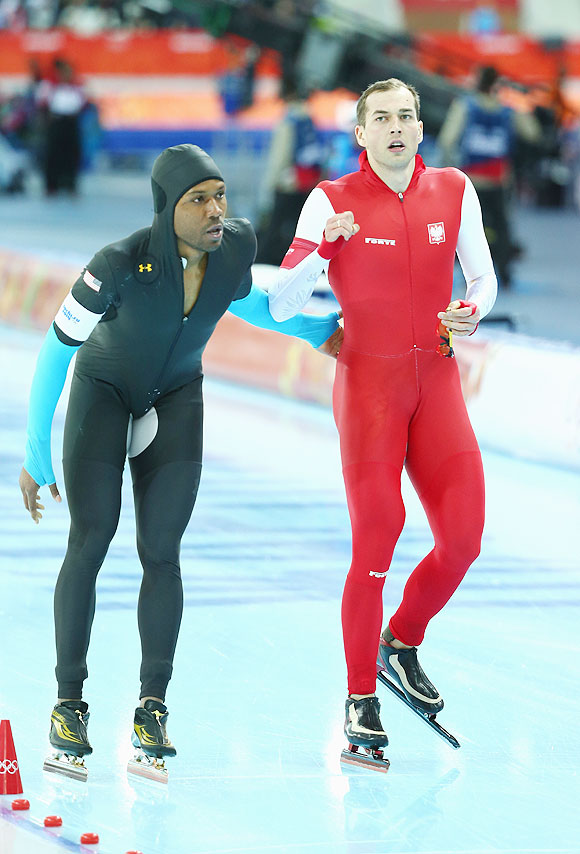 Zbigniew Brodka of Poland is congratulated by Shani Davis of US during the Speed Skating Men's 1500m at Adler Arena Skating Center on Saturday
