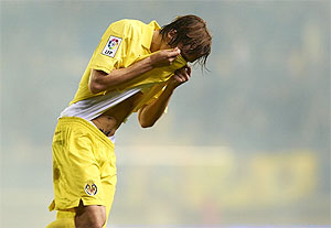 Tomas Pina of Villarreal reacts after a tear gas canister is thrown in the stands during the La Liga match between Villarreal CF and RC Celta de Vigo at El Madrigal in Villarreal on Saturday