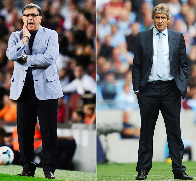 Head   coach Gerardo Martino of FC Barcelona,left, and Manchester City manager Manuel Pellegrini.