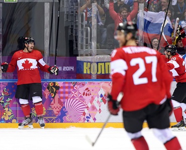 Ice hockey: Canada, US advance; Russia sweats