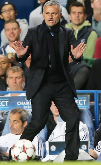 Manager Jose Mourinho of Chelsea looks on.