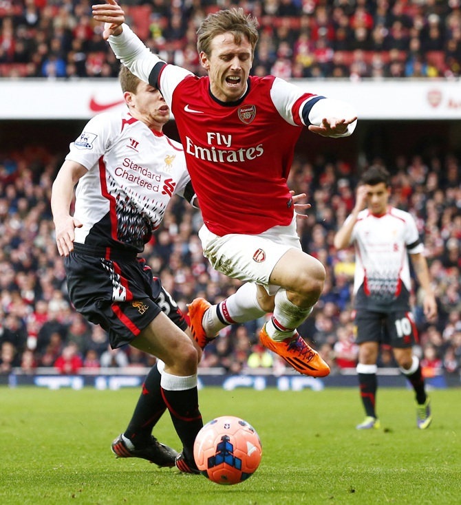 Arsenal's Nacho Monreal, right, is fouled by Liverpool's Jon Flanagan during their FA Cup match.