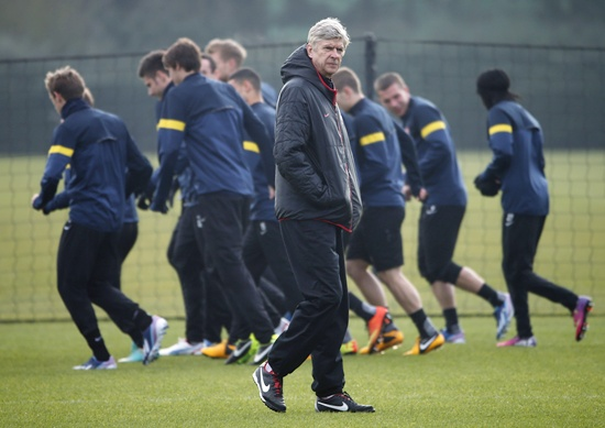 Arsenal manager Arsene Wenger attends a team training session.
