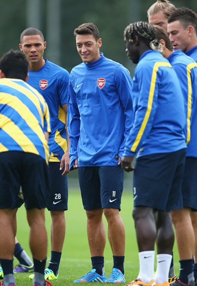 Mesut Ozil of Arsenal warms up during a training session.