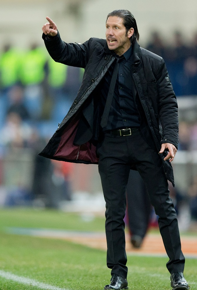 Head coach Diego Simeone of Atletico de Madrid gives instructions.