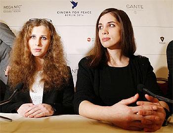 Russian punk band Pussy Riot members Maria Alyokhina (left) and Nadezhda Tolokonnikova