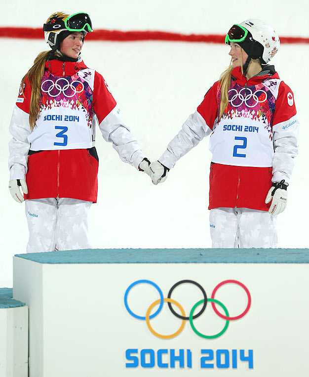Dufour-Lapointe of Canada and gold medalist Justine Dufour-Lapointe of Canada congratulate each other during the flower ceremony following the Ladies' Moguls Final at Rosa Khutor Extreme Park in Sochi