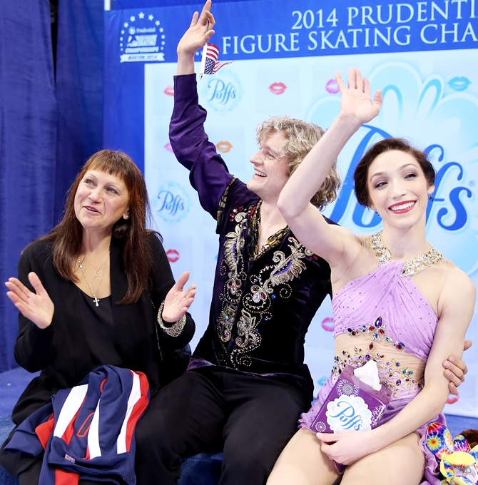 Charlie White and Meryl Davis, with their coach Marina Zueva, celebrate.