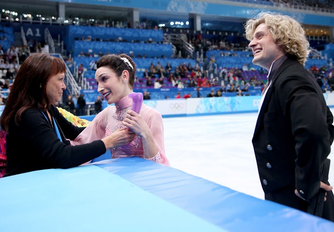 Meryl Davis and Charlie White of the United Stateswelcomed by their coach Marina Zoueva.
