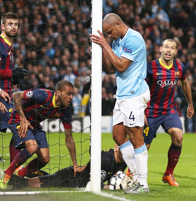 Vincent Kompany of Manchester City reacts to a missed chance during the Champions League Round of 16 first leg match against Barcelona.