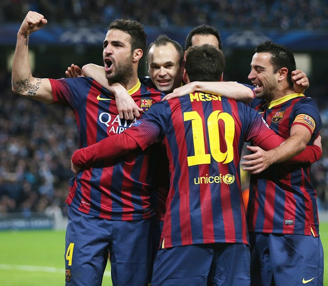 Lionel Messi of Barcelona celebrates scoring the opening goal from a penalty.