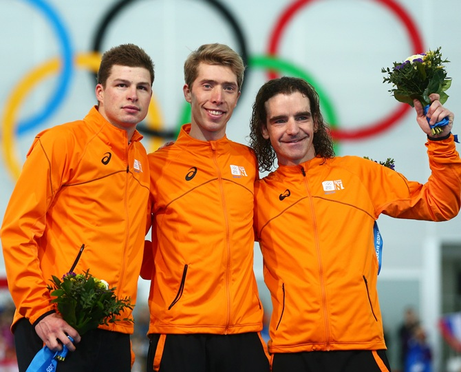 From left, Silver medalist Sven Kramer of the Netherlands, gold medalist Jorrit Bergsma of the Netherlands and bronze medalist Bob de Jong of the Netherlands celebrate.
