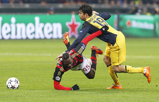 AC Milan's Mario Balotelli (left) is tackled by Atletico Madrid's Diego Costa on Wednesday