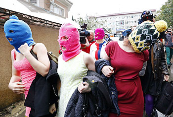Masked members of protest band Pussy Riot leave a police station in Adler during the 2014 Sochi Winter Olympics on Tuesday