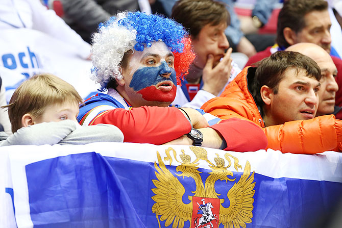 A dejected Russian fan watches the Men's Ice Hockey Quarterfinal Playoff against Finland at the 2014 Sochi Winter Olympics at Bolshoy Ice Dome on Wednesday