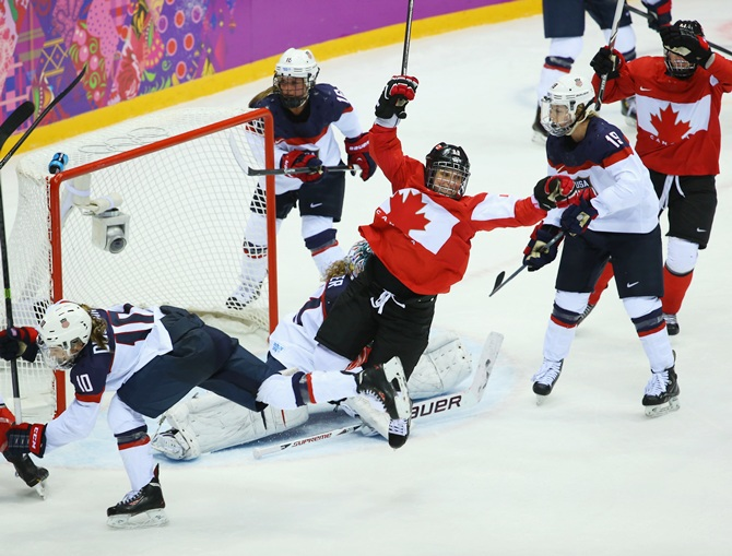 Marie-Philip Poulin of Canada celebrates after scoring against Jessie Vetter of the United States during the Ice Hockey Women's Gold Medal Game.