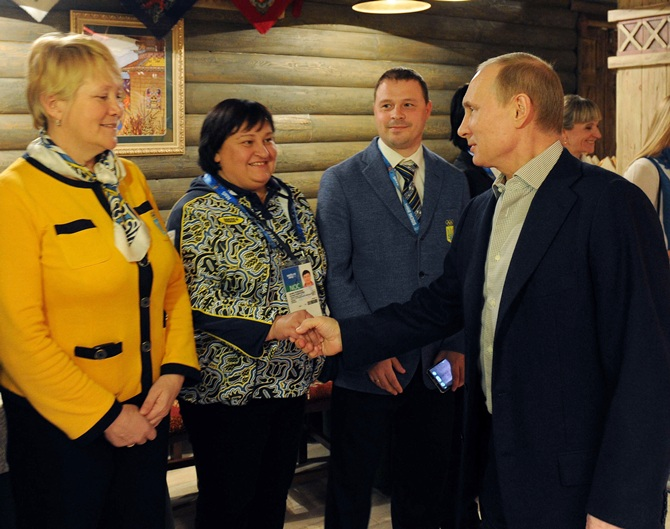 File Photo of Russia's President Vladimir Putin, centre, visiting Team Ukraine House at the Olympic Park.