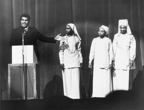 Muhammad Ali addressing a Nation of Islam meeting in London in December 1974.