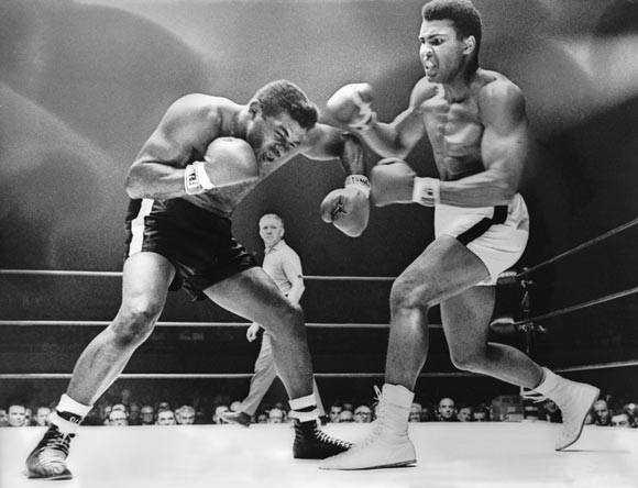 Cassius Clay (Muhammad Ali) spars with challenger Floyd Patterson during the World Heavyweight Championship fight. Clay won the fight with a technical knockout in the 12th round in November 1965.