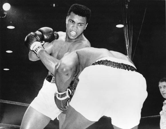 Cassius Clay (now Muhammad Ali) in action against Sonny Liston during their heavyweight title fight at Miami Beach, Florida. Clay won when Liston failed to come out in the seventh round.