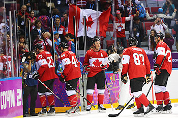 Canada's ice-hockey team celebrates after defeating USA in the semi-final at Sochi on Friday