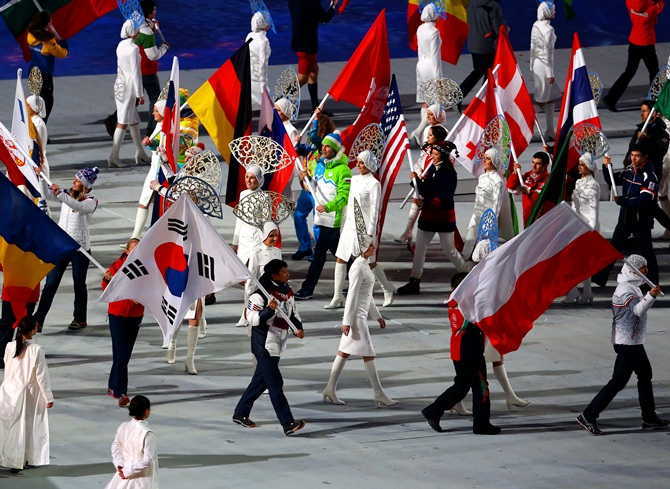 The flags of the competiting nations enter the arena during the 2014 Sochi Winter Olympics Closing Ceremony.