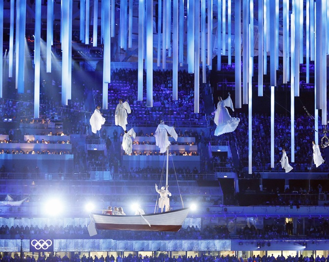 Performers and a giant rowboat are seen suspended in the air during the closing ceremony.