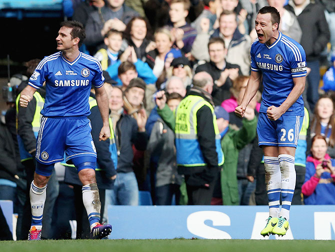 Frank Lampard of Chelsea (left) celebrates with teammates John Terry after the latter scored the winner agianst Everton at Stamford Bridge on Saturday