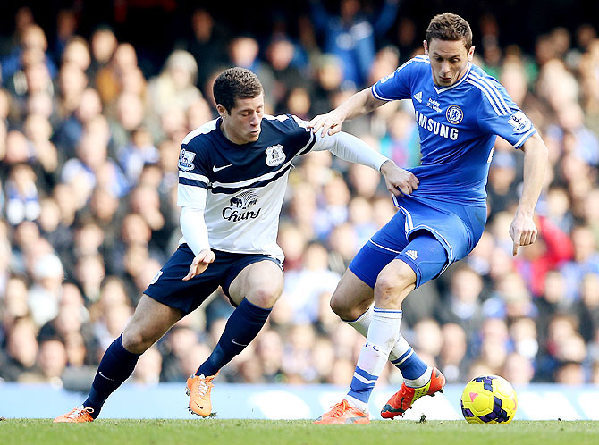 Ross Barkley of Everton (left) challenges Nemanja Matic of Chelsea during their Premier League match on Saturday