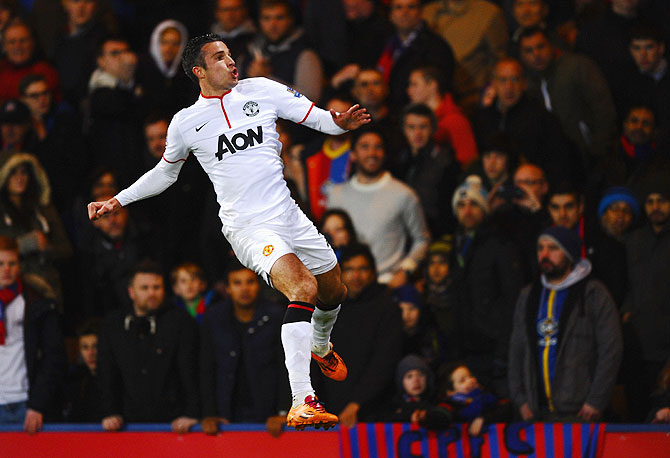 Robin Van Persie of Manchester United jumps for joy as he celebrates his goal against Crystal Palace at Selhurst Park in London on Saturday