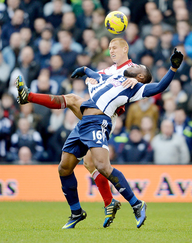 Victor Anichebe of West Brom is challenged by Steve Sidwell of Fulham during their Premier League match at The Hawthorns in West Bromwich on Saturday