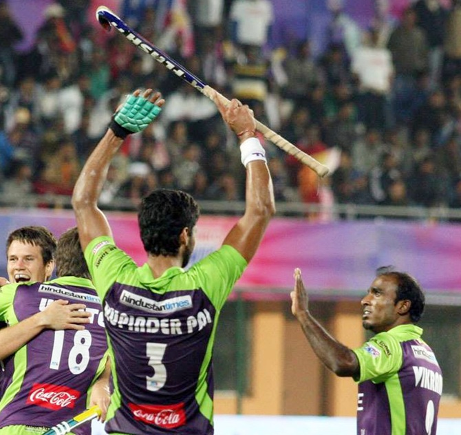 Rupinderpal Singh of Delhi Waveriders celebrates with teammates