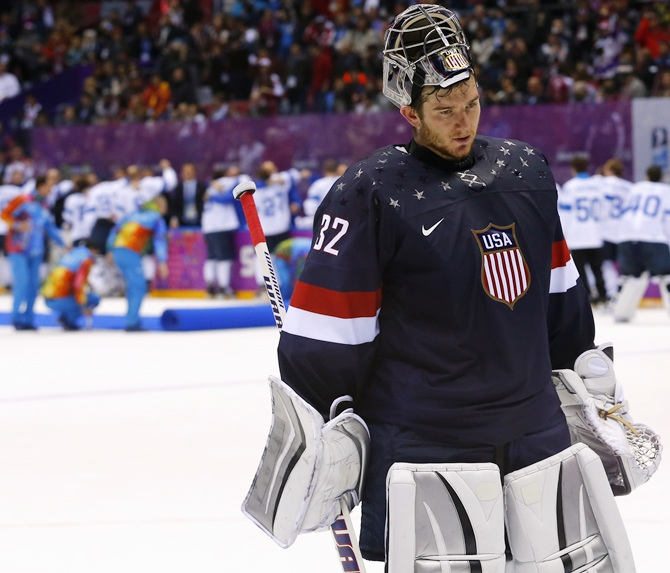Team USA's goalie Jonathan Quick leaves the ice after being defeated by Finland during the men's ice hockey bronze medal game at the Sochi.