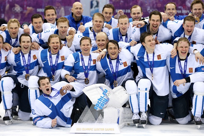 Bronze medalists Finland celebrate after defeating the United States 5-0 during the Men's Ice Hockey Bronze Medal Game.